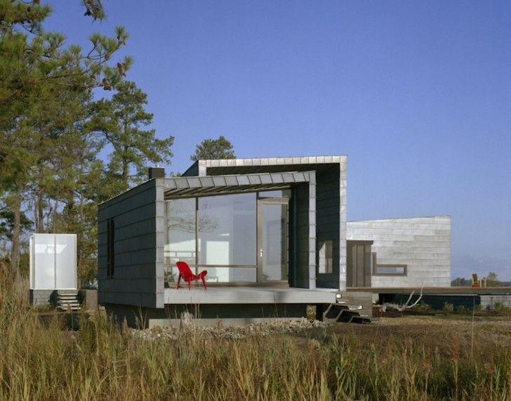Hurricane resistant cabins overlook coastal marshlands in for Hurricane proof home plans