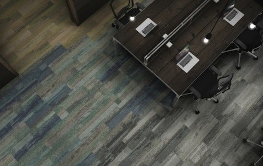 Interface recycles fishing nets and reclaimed fibers into cozy, earth-toned carpet tiles
