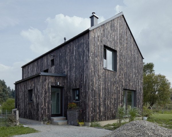 Carbon House, Mjölk Architekti, timber home, timber house, Pyšely, timber facade, charred timber, charred timber plans, timber planks, natural light, whitewashed walls, exposed timber ceiling beams, timber ceiling beams,