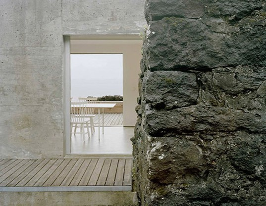 SAMI Arquitectos, concrete home, concrete, ruins, ruined walls, green renovation, island house, holiday home, portuguese architects, Lisbon, terrace, natural light