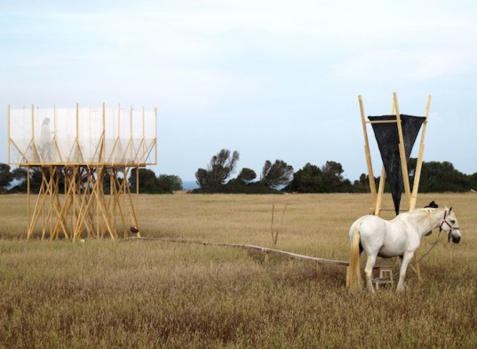 Gartnerfuglen, Grooming Retreat, horse grooming, Marian de Delás, horses, spain, timber structure, elevated structure, horse station, mosquito net, white netting, natural light, barley field, timber platform, Mallorca
