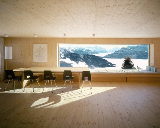 AFGH Architects, Switzerland, holiday home, timber architecture, Swiss alps, Rigi, alps, contemporary interior, reflective light, concrete cellar, kinked floor plan, panoramic windows, snow covered mountains,