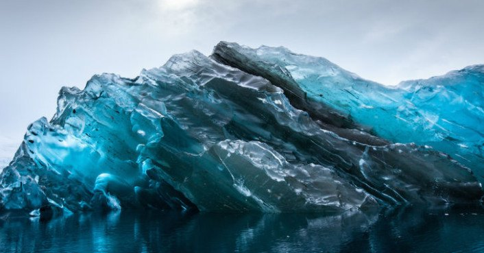 Capsized iceberg resembles a sapphire in the Southern Ocean