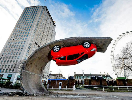 Alex Chinneck, gravity-defying artwork, art installation, 'Pick yourself up and pull yourself together,' Vauxhall Motors, Vauxhall Corsa, illusory artwork, tarmac, temporary art,