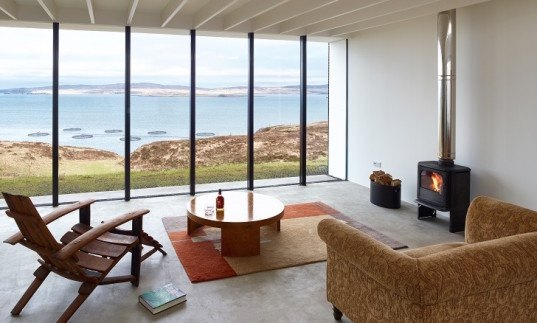 Cliff House, Dualchas Architects, Isle of Skye, Scotland, clerestory windows, clerestory glazing, floor to ceiling windows, seaside views, Caithness stone, larch,