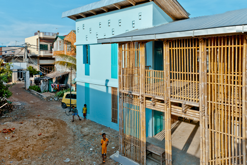 Eco-friendly youth center is built from bamboo, earth bricks, and recycled plastic bottles in Phnom Penh