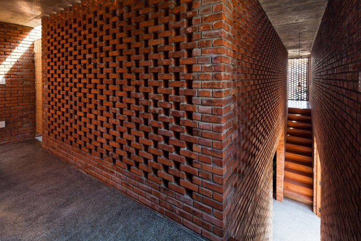 Passively cooled termitary house in vietnam is wrapped in for Perforated brick wall
