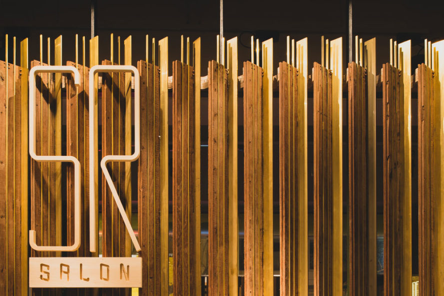 Salon Is Renovated With Wood Panels Reclaimed From Hong