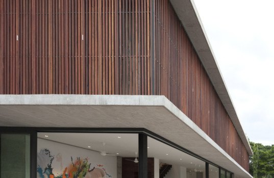 Swiss Thai House Combines Reclaimed Materials With A