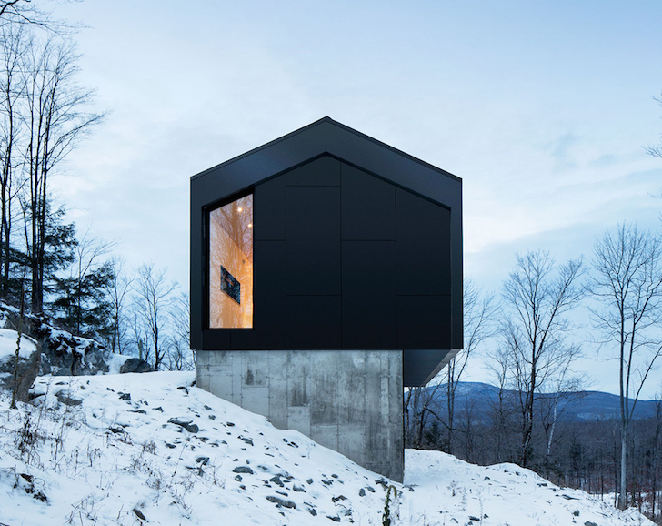 Minimalist Cabin minimalist steel cabin floats above a rugged slope in quebec
