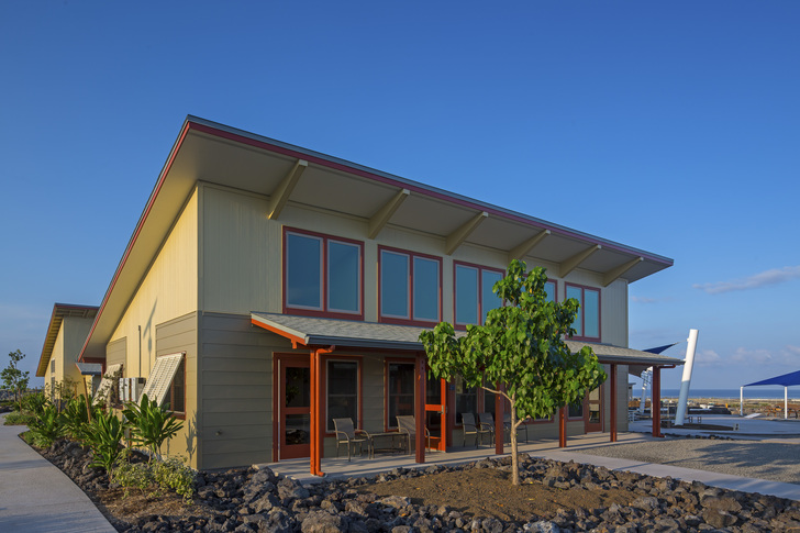 Sustainable school features an outdoor auditorium and reef for Exterior design school