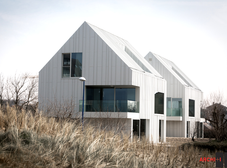 Pitched blanco oostduinkerke residence conceals parking for Coastal architecture design