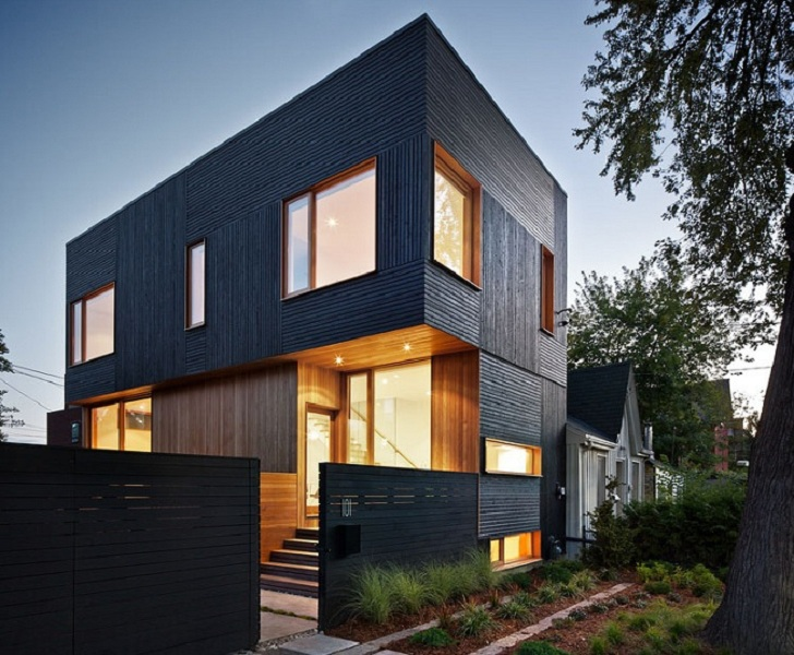 house 3 is a green roofed modern home in toronto that seems to glow