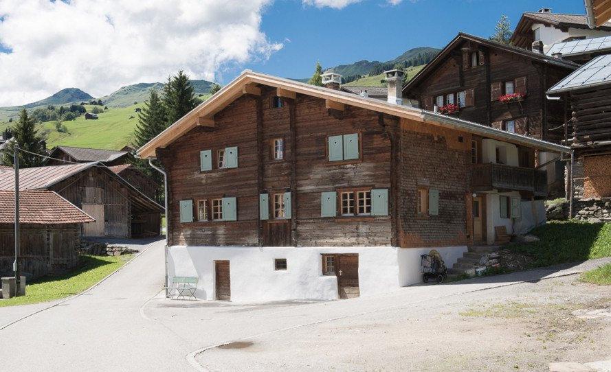 Traditional Swiss Ski Chalet Renovated Into Two Modern Flex Space