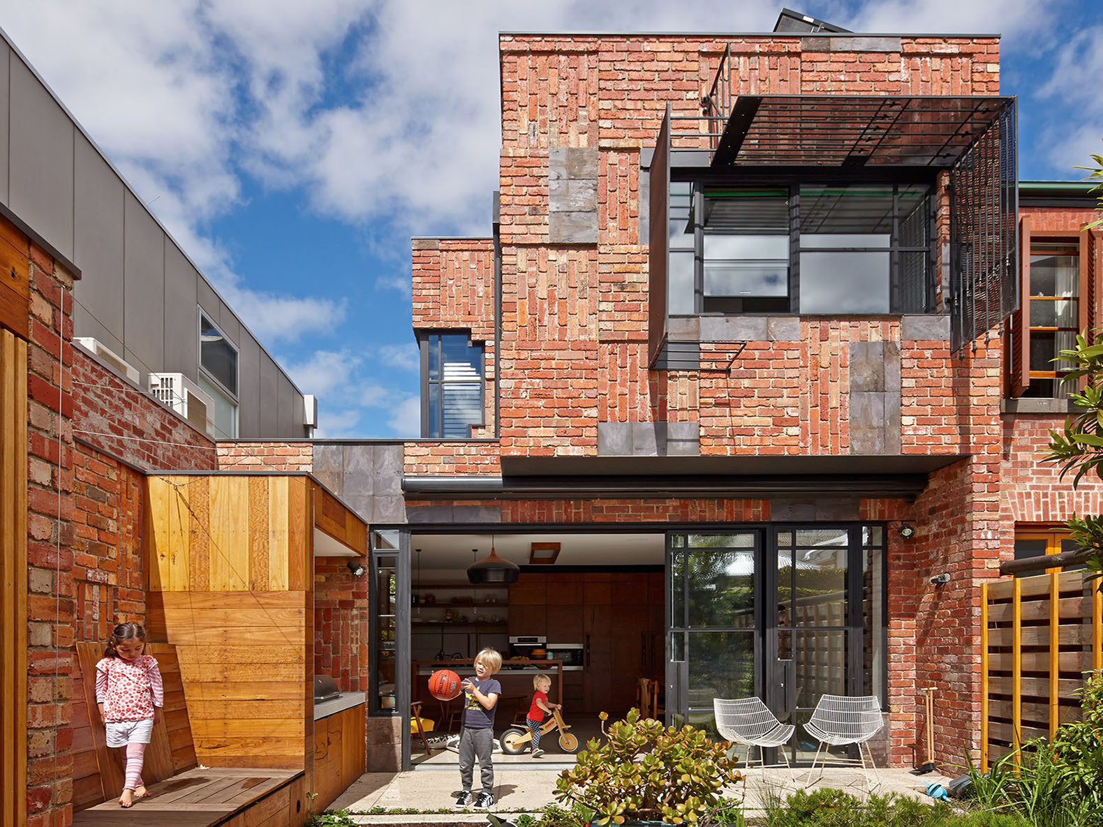 PHOOEY Architects\' Cubo House extension incorporates salvaged ...