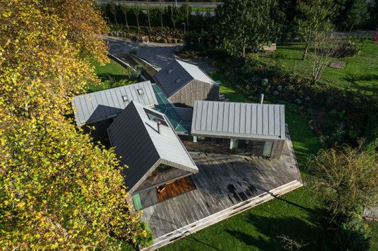 PROD Arquitectura, Portugal, House of Four Houses, green architecture, pitched roof, vernacular architecture, natural light, mezzanine, deck terrace, mobile partitions, glass-to-ceiling windows