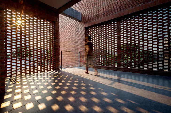 Perforated brick screens create private space amidst busy for Perforated brick wall