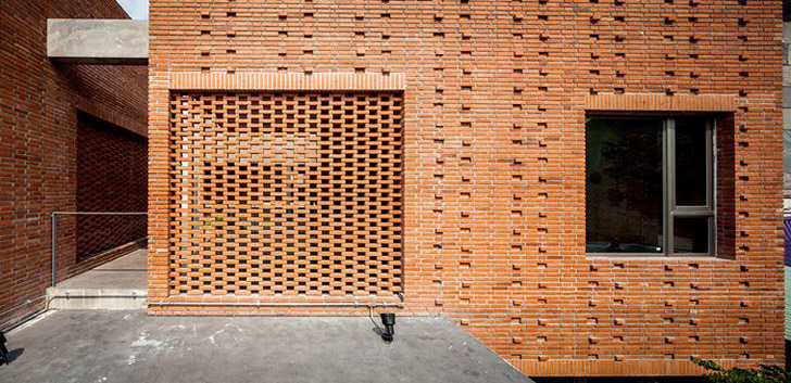 Perforated Brick Screens Create Private Space Amidst Busy