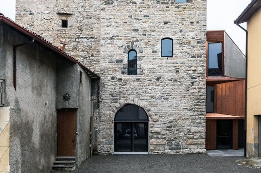 Gianluca Gelmini, Torre del Borgo, Bergamo, Italy, green renovation, fortified tower, green tower, stone building, medieval building restoration, public library, ramps and walkways, iron stairs