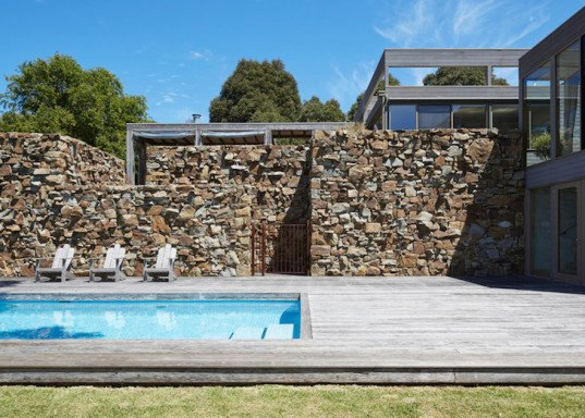 Locally Sourced Rock Fence Creates A Natural Wind Break