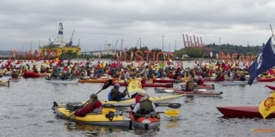 shell oil, seattle port, shell drilling rig seattle, shell oil in seattle, seattle protesters, seattle kayakers, seattle protesters on kayaks and paddleboards, greenpeace seattle, greenpeace usa