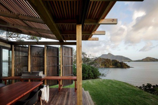 new zealand summer house, summer beach house, herbst architects, kiwi bach, new zealand bach, hillside home, summer vacation house, open air building, transforming architecture, castle rock beach house