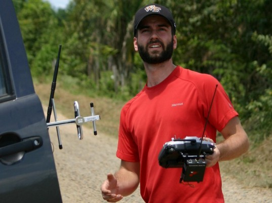 Max Messinger of Wake Forest University flies a drone in the Peruvian Amazon. Amazon drones, drones in the amazon