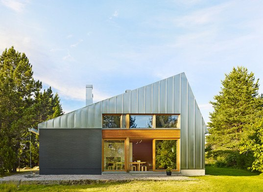 Metal clad house l is a contemporary holiday retreat in for Metal building house conversion