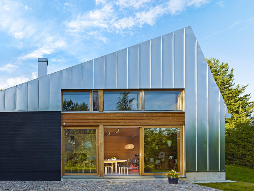 Metal clad house l is a contemporary holiday retreat in for Modern metal building