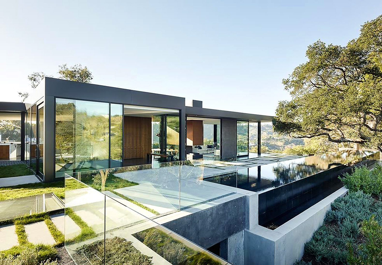 Gorgeous cantilevering green roofed home soars over beverly hills