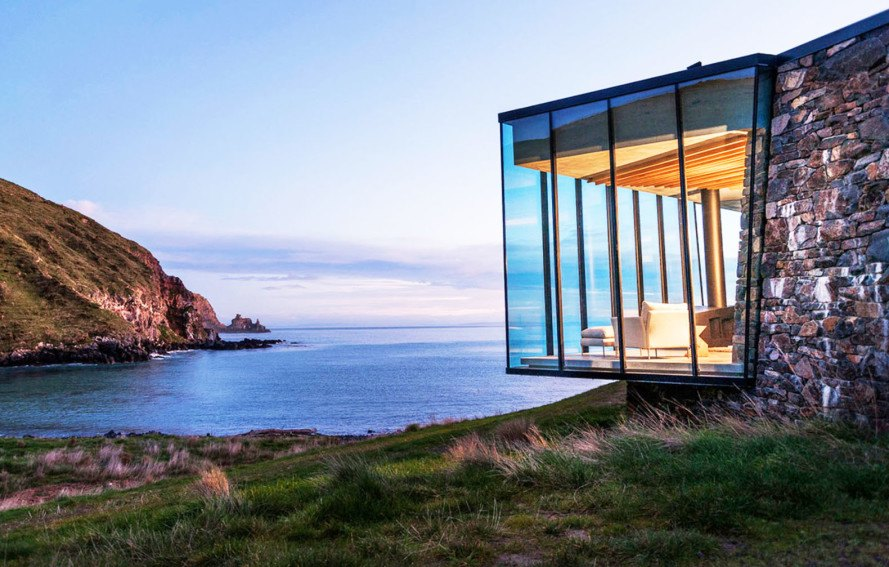 Annandale Seascape Cottage, Pattersons, New Zealand, green retreat, green cottage, rainwater harvesting, reforestation, earthquake-resistant home, glass facade, seaside home