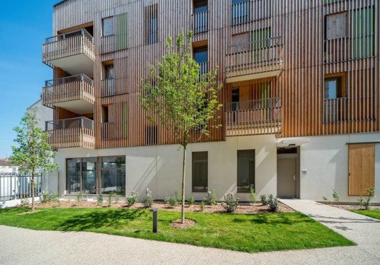 Tectône, Tectône architects, Housing in Auvry Barbusse, Housing in Auvry Barbusse by Tectône, wooden housing, timber framed housing, timber house, recycled rainwater, double-skin facade, untreated pine, patina, solar shading, natural daylight, Paris housing, Aubervilliers, prefab,