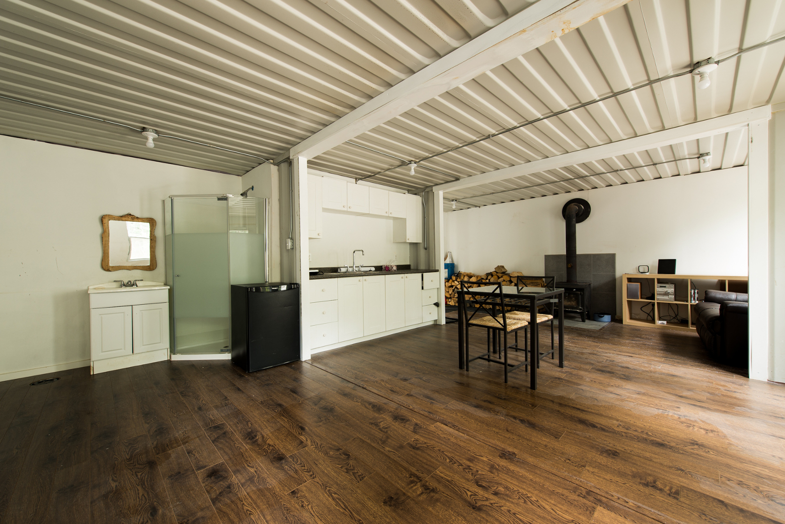 A Canadian Man Built This Off Grid Shipping Container Home For Just $20,000  Joseph Dupuis Shipping Container Home Wood Burning Stove U2013 Inhabitat    Green ...