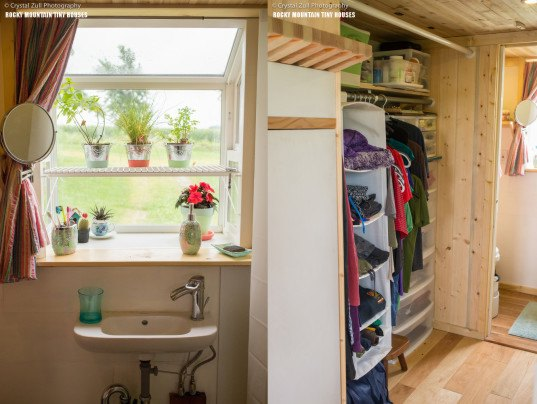 Pequod, Rocky Mountain Tiny Houses, Pequod by Rocky Mountain Tiny Houses, LEDs, tiny house, tiny homes, Nature's Head composting toilet, composting toilet, wood stove, porthole windows, Douglas Fir, transforming furniture, multifunctional furniture, integrated storage,