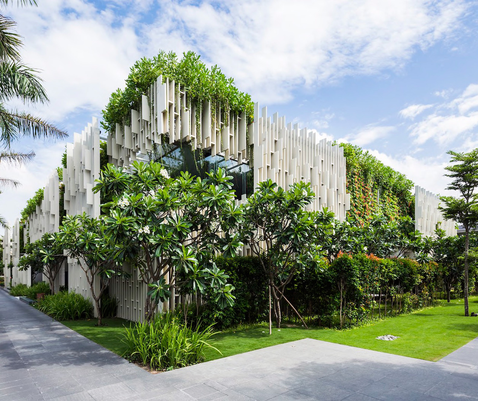 Lush living plants engulf the green roofed Pure Spa in Vietnam