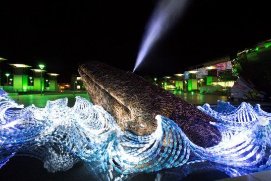 These life-sized willow whales swim through a sea of plastic bottles to raise pollution awareness