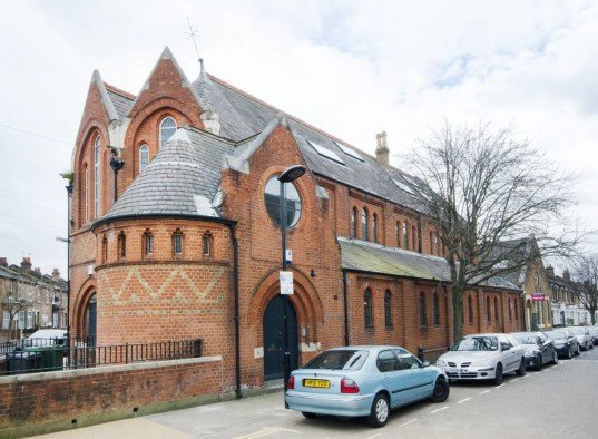 london church renovation, church converted into house, kensington london, london real estate, converted houses, open floor plan, stained glass, church architecture