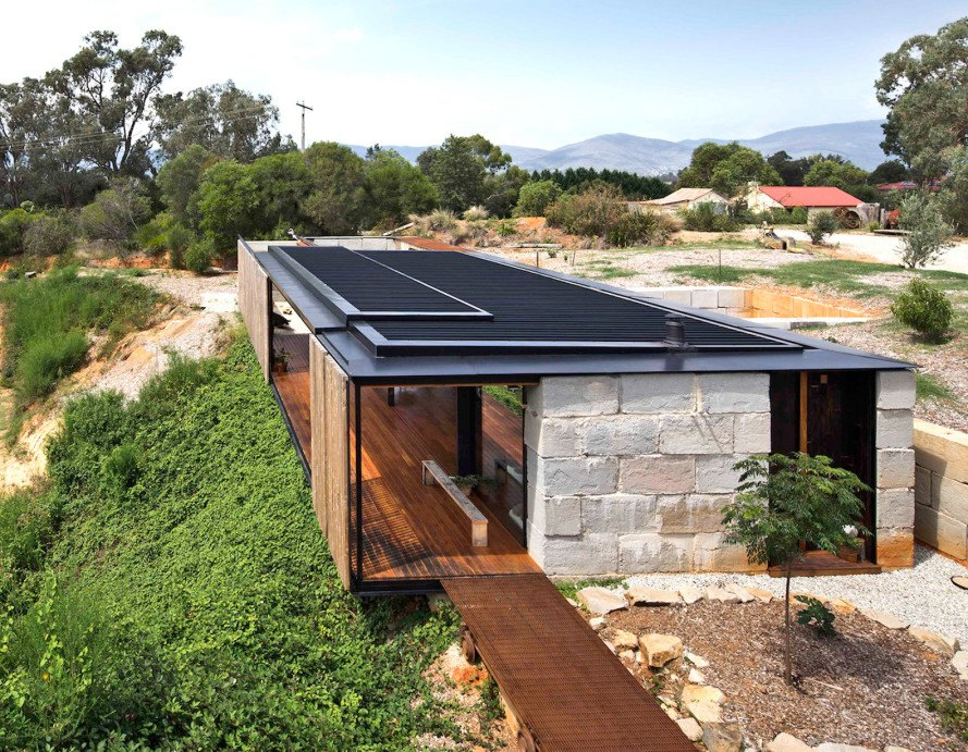 Industrial modern sawmill house is built from recycled for Building a concrete block house