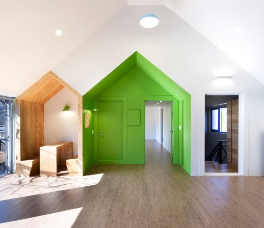 UTAA, Pinocchio, Pinocchio children's center, renovation, renovated building, South Korea, Unak Mountain, Poneok, larch, larch wood, gabled extension, glazed end wall, high ceilings,  book cafe, house within a house, house in a house, house inside a house,