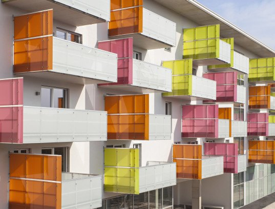 Glanhof housing, glass facade, multifamily housing, social housing, Austria, Architects Collective, solar design, solar panels, heat pump, geothermal, solar power, green architecture