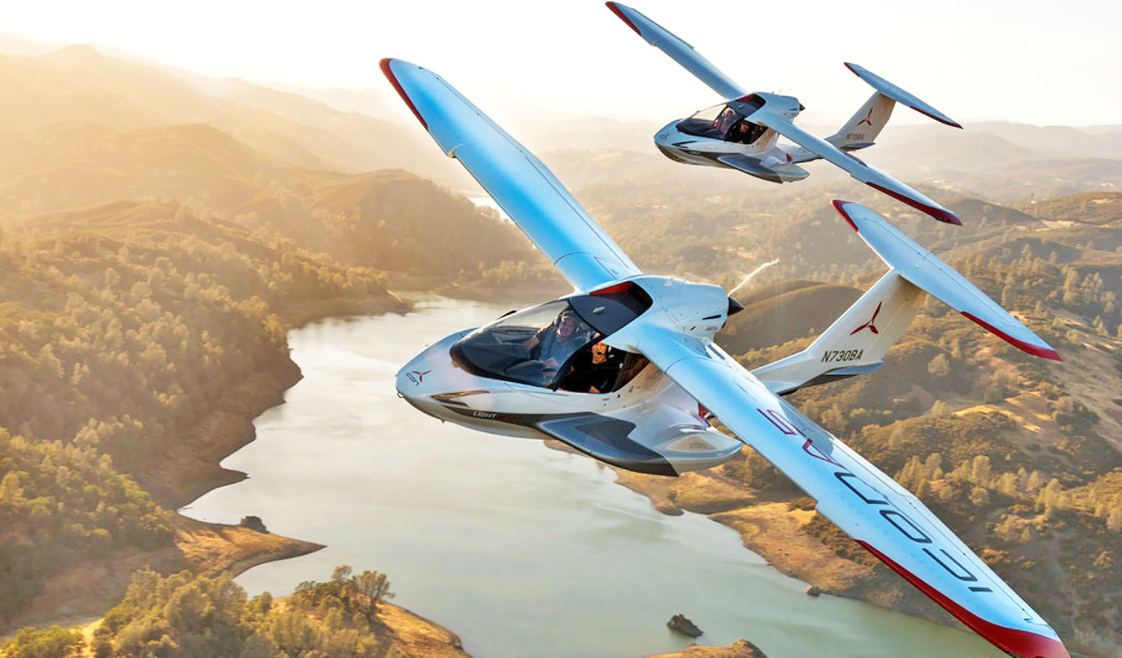 Amphibious airplane's wings fold up to fit in a camper