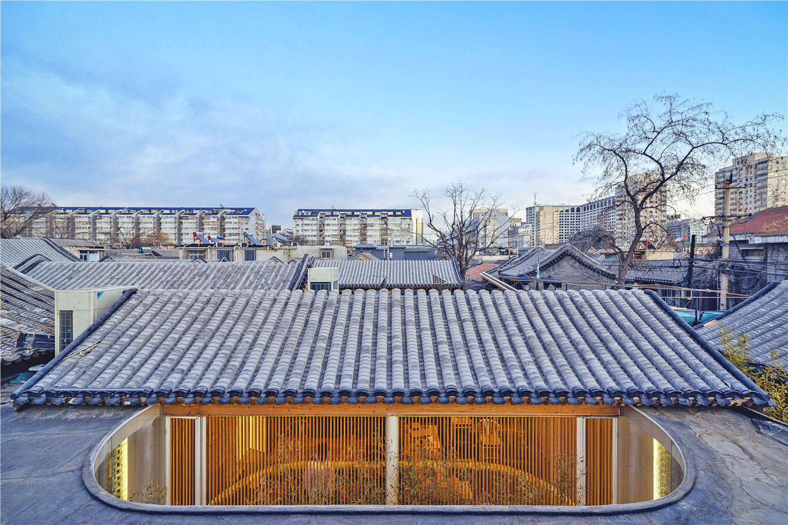 ARCHSTUDIO Inserts A Modern Teahouse Into An Ancient Chinese Structure