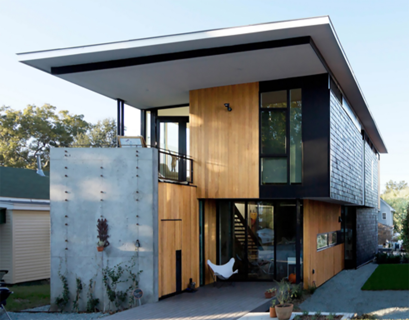 Two compact modern homes fill challenging empty lots in an for Modern house builders
