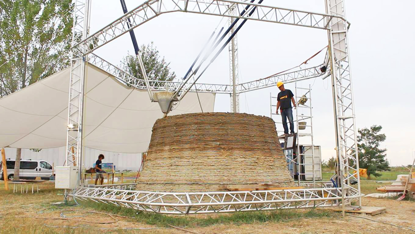 The world's largest Delta 3D printer creates nearly zero-cost homes out of mud