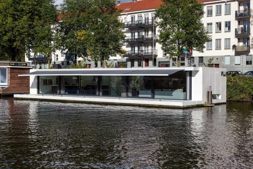+31 Architects, houseboat, Watervilla Weesperzijde, Amsterdam, Amstel river, Dutch architecture, floating home, LEDs light display, floating wooden terrace