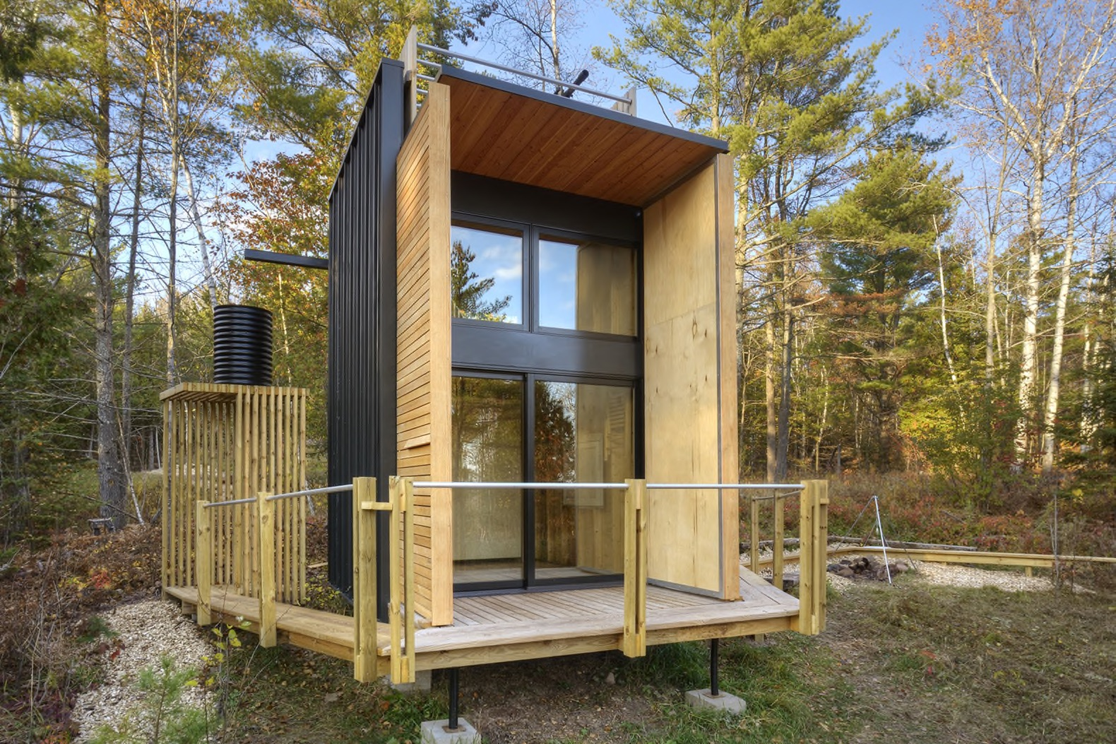 Father and son build a tiny off the grid cabin in for Building a house in wisconsin