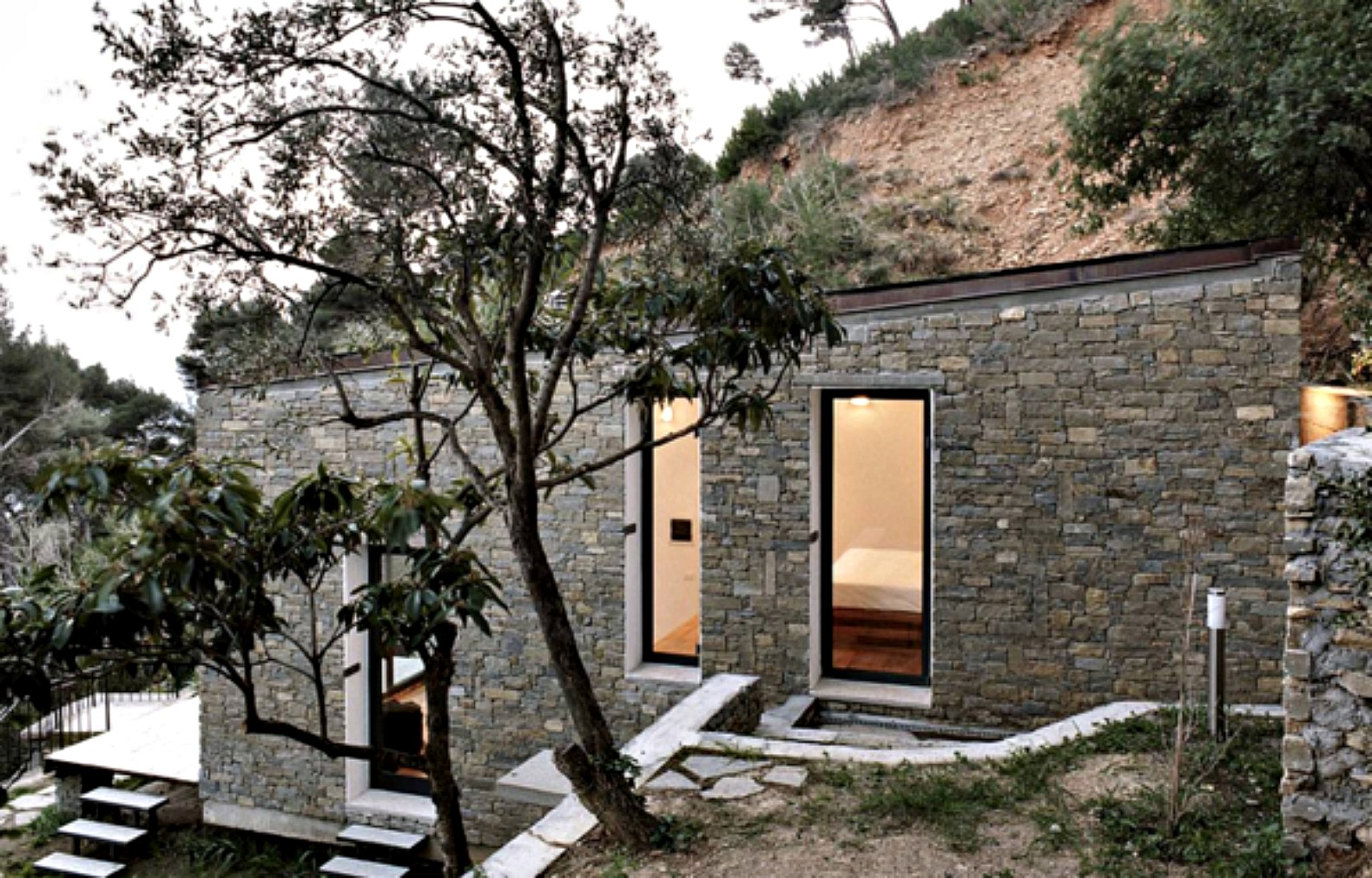377-square foot home built into the Turin hillside hides a full kitchen under the stairs