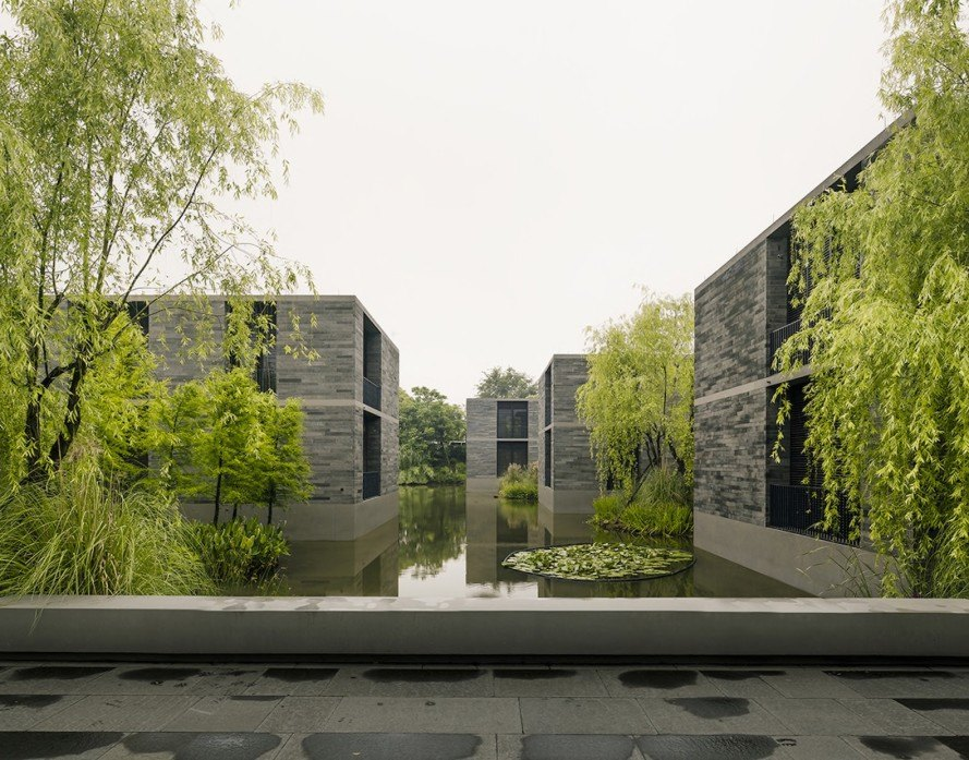 David Chipperfield, Xixi Wetland Estate, Xixi Wetland Estate by David Chipperfield Architects, David Chipperfield Architects, wetland, Hangzhou, water garden, marshland, stone apartments, Chinese architecture,