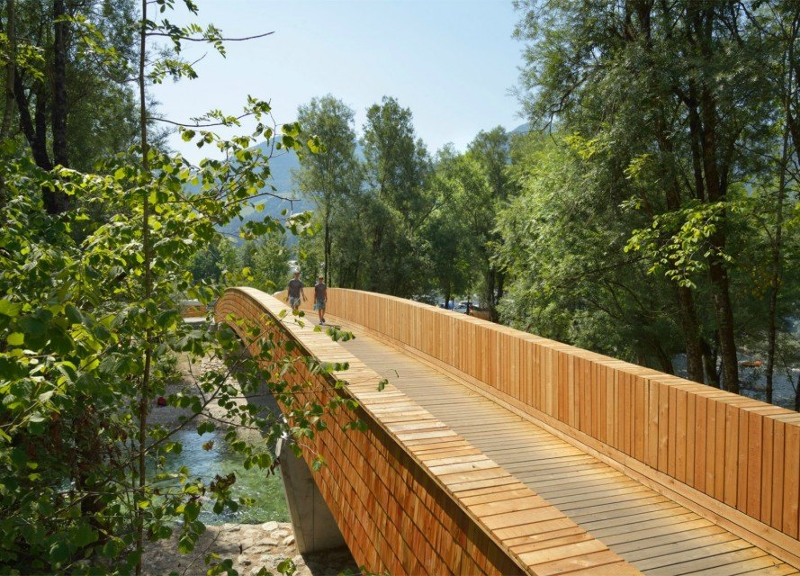 DANS Architects, wooden footbridge,Vlatka Ljubanovic, bicycle path, bridge design, wooden bridges, arching bridge design, bridge Slovenian village, timber planks and shingles bridge, Sava River bridge, spruce wooden bridge, timber bridge,