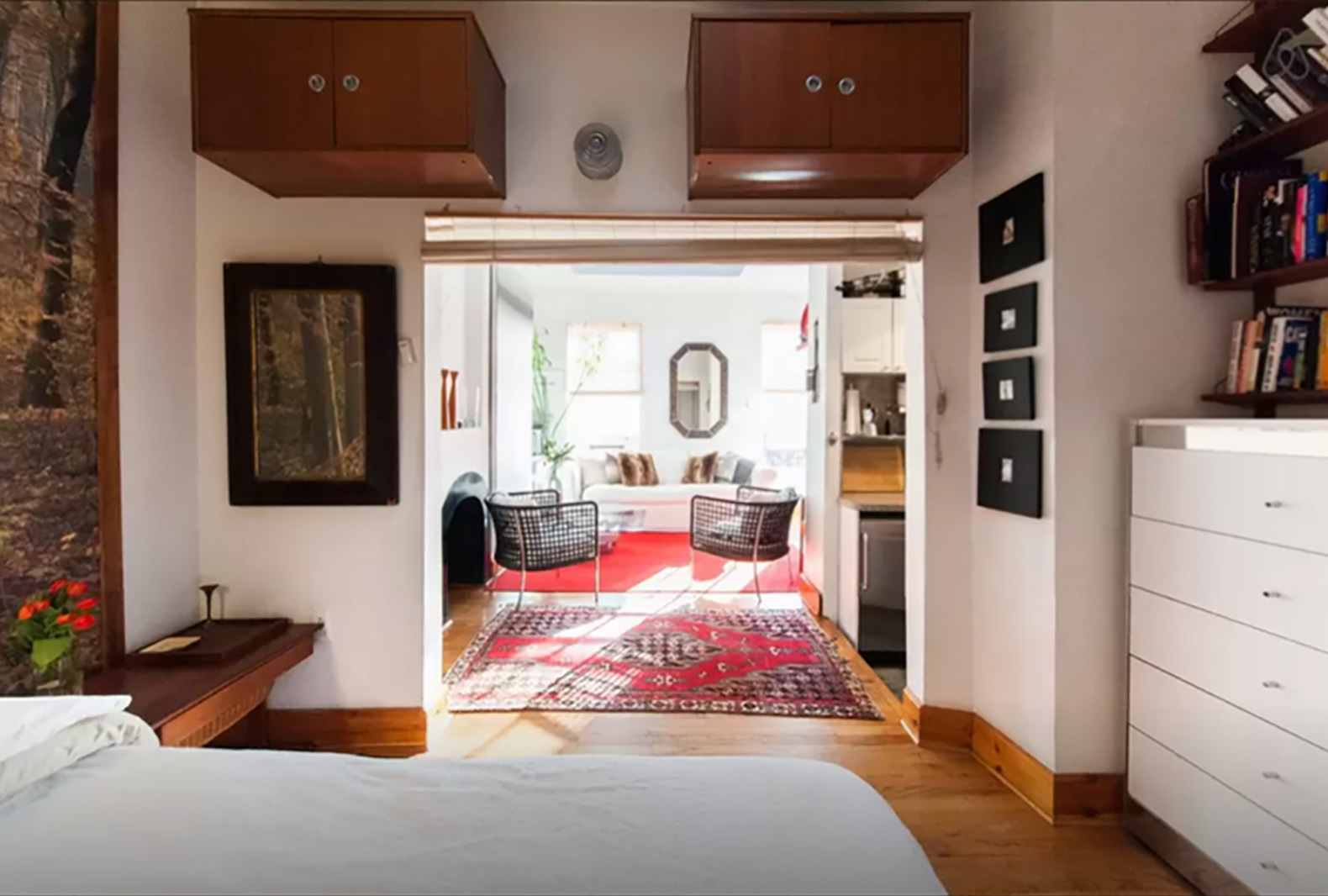 Stylish 325sqft studio uses a clever design trick to create the